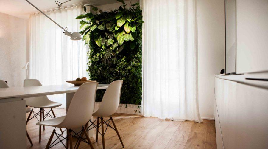 salotto_giardinoverticale_giardino_verticale_casa_soggiorno_ingresso_tavolo_corian_cucina